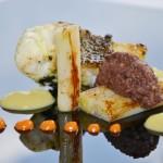 Peix de llotja, calçots, romesco i botifarra